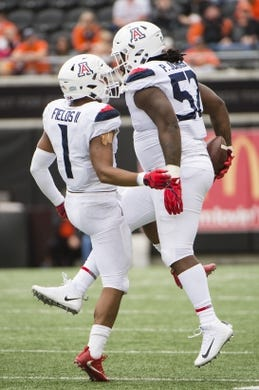 Sep 22, 2018; Corvallis, OR, USA; Arizona Wildcats linebacker Tony Fields II (1) and Arizona Wildcats cornerback Lorenzo Burns (2) celebrate after sacking Oregon State Beavers quarterback Conor Blount (2) during the first half at Reser Stadium. Mandatory Credit: Troy Wayrynen-USA TODAY Sports