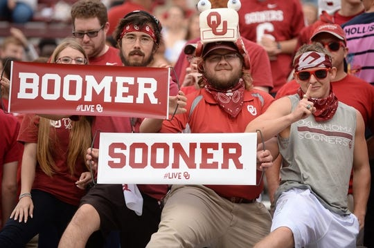 Sep 22, 2018; Norman, OK, USA; Fans get ready to cheer prior to action between the Oklahoma Sooners and the Army Black Knights at Gaylord Family - Oklahoma Memorial Stadium. Mandatory Credit: Mark D. Smith-USA TODAY Sports