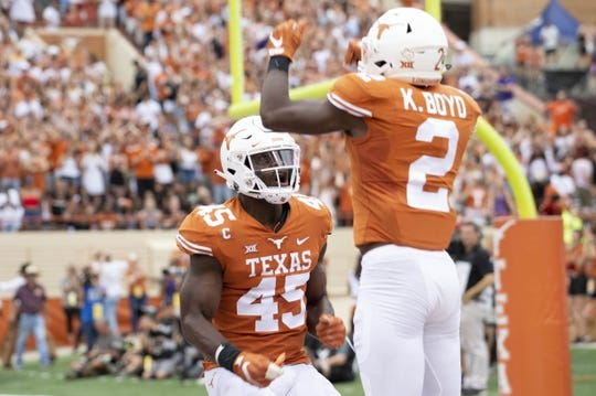 Sep 22, 2018; Austin, TX, USA; Texas Longhorns linebacker Anthony Wheeler (45) celebrates with Texas Longhorns defensive back Kris Boyd (2) after Texas blocked a pass from the Texas Christian Horned Frogs during the first quarter at Darrell K Royal-Texas Memorial Stadium. Mandatory Credit: Bethany Hocker-USA TODAY Sports