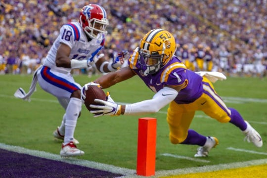 Sep 22, 2018; Baton Rouge, LA, USA; LSU Tigers wide receiver Ja'Marr Chase (1) dives in to the end zone against Louisiana Tech Bulldogs cornerback Zach Hannibal (18) but is out at the one yard line at Tiger Stadium. Mandatory Credit: Stephen Lew-USA TODAY Sports