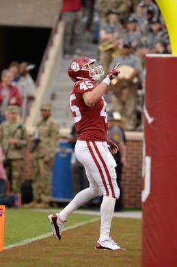 Sep 22, 2018; Norman, OK, USA; Oklahoma Sooners fullback Carson Meier (45) celebrates after a touchdown against the Army Black Knights during the first quarter at Gaylord Family - Oklahoma Memorial Stadium. Mandatory Credit: Mark D. Smith-USA TODAY Sports