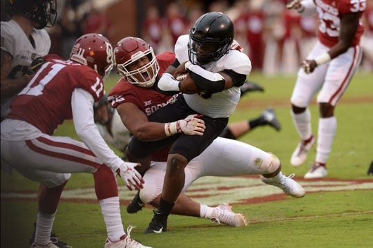Sep 22, 2018; Norman, OK, USA; Oklahoma Sooners defensive end Amani Bledsoe (72) tackles Army Black Knights quarterback Kelvin Hopkins Jr. (8) during the first quarter at Gaylord Family - Oklahoma Memorial Stadium. Mandatory Credit: Mark D. Smith-USA TODAY Sports