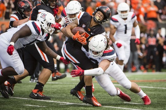 Sep 22, 2018; Corvallis, OR, USA; Arizona Wildcats linebacker Colin Schooler (7) tackles Oregon State Beavers wide receiver Trevon Bradford (8) during the second half at Reser Stadium. The Arizona Wildcats won 35-14. Mandatory Credit: Troy Wayrynen-USA TODAY Sports