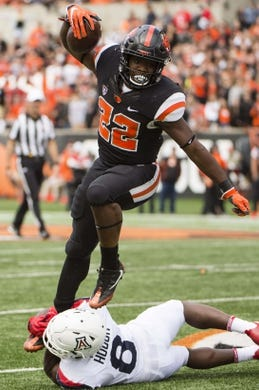 Sep 22, 2018; Corvallis, OR, USA; Oregon State Beavers running back Jermar Jefferson (22) leaps over Arizona Wildcats cornerback Tim Hough (8) during the second half at Reser Stadium. The Arizona Wildcats won 35-14. Mandatory Credit: Troy Wayrynen-USA TODAY Sports