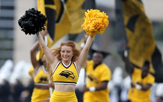 Sep 22, 2018; Hattiesburg, MS, USA; A Southern Miss Golden Eagles cheerleader runs onto the field before their game against the Rice Owls at M. M. Roberts Stadium. Mandatory Credit: Chuck Cook-USA TODAY Sports