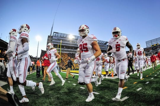 Sep 22, 2018; Iowa City, IA, USA; Wisconsin Badgers running back Chris James (5) and teammates head off the field before the game against the Iowa Hawkeyes at Kinnick Stadium. Mandatory Credit: Jeffrey Becker-USA TODAY Sports