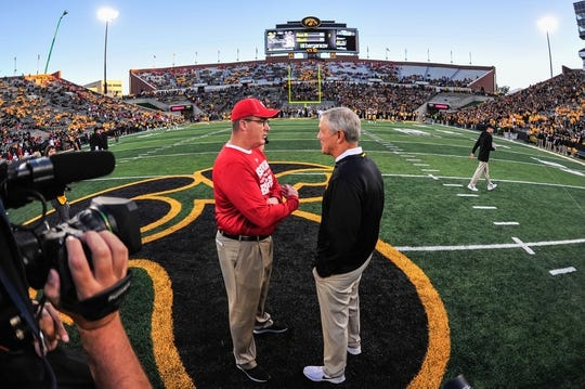 Sep 22, 2018; Iowa City, IA, USA; Iowa Hawkeyes head coach Kirk Ferentz (right) and Wisconsin Badgers head coach Paul Chryst talk before the game at Kinnick Stadium. Mandatory Credit: Jeffrey Becker-USA TODAY Sports