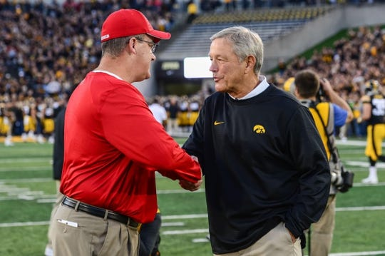 Sep 22, 2018; Iowa City, IA, USA; Iowa Hawkeyes head coach Kirk Ferentz (right) and Wisconsin Badgers head coach Paul Chryst shake hands before the game at Kinnick Stadium. Mandatory Credit: Jeffrey Becker-USA TODAY Sports