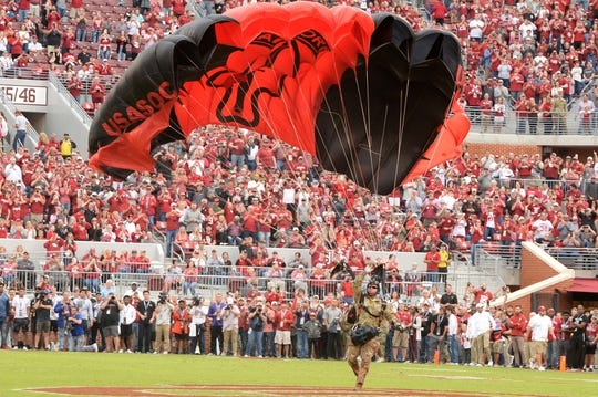 Sep 22, 2018; Norman, OK, USA; A member of the Army Black Knights parachute team lands on the field prior to action against the Oklahoma Sooners at Gaylord Family - Oklahoma Memorial Stadium. Mandatory Credit: Mark D. Smith-USA TODAY Sports