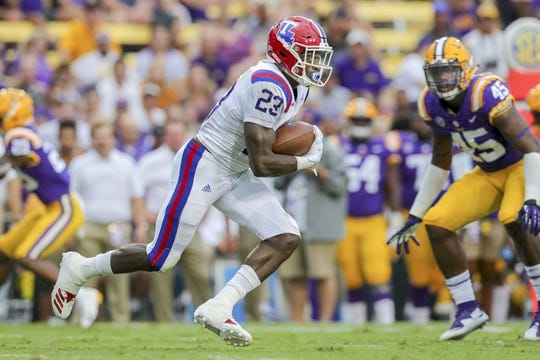 Sep 22, 2018; Baton Rouge, LA, USA; Louisiana Tech Bulldogs running back Jaqwis Dancy (23) runs against the LSU Tigers in the first quarter at Tiger Stadium. Mandatory Credit: Stephen Lew-USA TODAY Sports