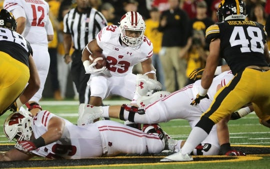 Sep 22, 2018; Iowa City, IA, USA; Wisconsin running back Jonathan Taylor (23) runs against the Iowa defense at Kinnick Stadium. Mandatory Credit: Mark Hoffman/Milwaukee Journal Sentinel via USA TODAY Sports