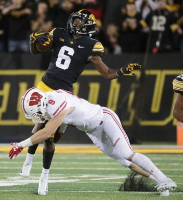 Sep 22, 2018; Iowa City, IA, USA; Wisconsin safety Scott Nelson (9) misses a tackle on Iowa wide receiver Ihmir Smith-Marsette (6) during the first  quarter at Kinnick Stadium. Mandatory Credit: Mark Hoffman/Milwaukee Journal Sentinel via USA TODAY Sports
