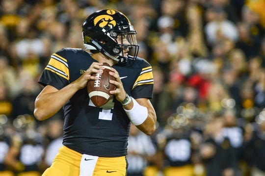 Sep 22, 2018; Iowa City, IA, USA; Iowa Hawkeyes quarterback Nate Stanley (4) prepares to throw a pass against the Wisconsin Badgers during the first quarter at Kinnick Stadium. Mandatory Credit: Jeffrey Becker-USA TODAY Sports
