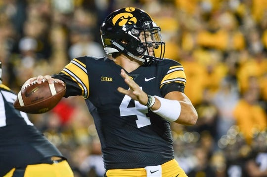Sep 22, 2018; Iowa City, IA, USA; Iowa Hawkeyes quarterback Nate Stanley (4) throws a pass against the Wisconsin Badgers during the first quarter at Kinnick Stadium. Mandatory Credit: Jeffrey Becker-USA TODAY Sports