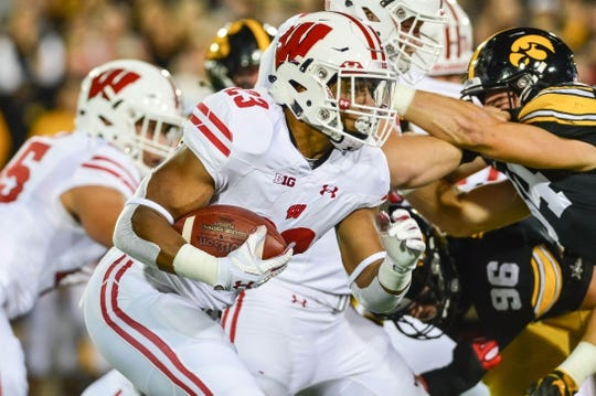 Sep 22, 2018; Iowa City, IA, USA; Wisconsin Badgers running back Jonathan Taylor (23) runs the ball against the Iowa Hawkeyes during the first quarter at Kinnick Stadium. Mandatory Credit: Jeffrey Becker-USA TODAY Sports