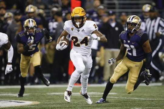 Sep 22, 2018; Seattle, WA, USA; Arizona State Sun Devils defensive back Chase Lucas (24) returns an interception against the Washington Huskies during the first quarter at Husky Stadium. Mandatory Credit: Jennifer Buchanan-USA TODAY Sports