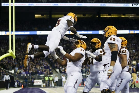 Sep 22, 2018; Seattle, WA, USA; Arizona State Sun Devils offensive lineman Steven Miller (71) throws running back Eno Benjamin (3) up in the air after Benjamin scored a touchdown against the Washington Huskies during the first quarter at Husky Stadium. Mandatory Credit: Jennifer Buchanan-USA TODAY Sports