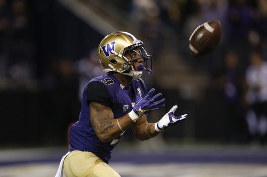 Sep 22, 2018; Seattle, WA, USA; Washington Huskies running back Myles Gaskin (9) catches a kick off against the Arizona State Sun Devils during the first quarter at Husky Stadium. Mandatory Credit: Jennifer Buchanan-USA TODAY Sports
