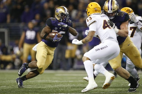 Sep 22, 2018; Seattle, WA, USA; Washington Huskies running back Salvon Ahmed (26) rushes the ball against the Arizona State Sun Devils during the first quarter at Husky Stadium. Mandatory Credit: Jennifer Buchanan-USA TODAY Sports