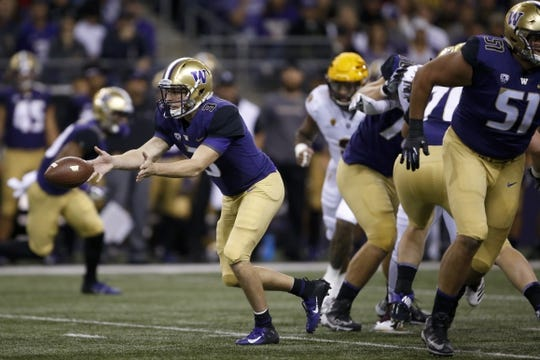 Sep 22, 2018; Seattle, WA, USA; Washington Huskies quarterback Jake Browning (3) pitches the ball against the Arizona State Sun Devils during the first quarter at Husky Stadium. Mandatory Credit: Jennifer Buchanan-USA TODAY Sports