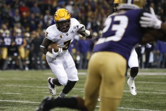 Sep 22, 2018; Seattle, WA, USA; Arizona State Sun Devils running back Eno Benjamin (3) rushes the ball against the Washington Huskies during the first quarter at Husky Stadium. Mandatory Credit: Jennifer Buchanan-USA TODAY Sports