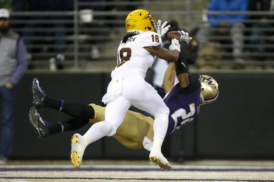 Sep 22, 2018; Seattle, WA, USA; Washington Huskies wide receiver Ty Jones (20) catches a touchdown pass over Arizona State Sun Devils cornerback Langston Frederick (18) during the first quarter at Husky Stadium. Mandatory Credit: Jennifer Buchanan-USA TODAY Sports