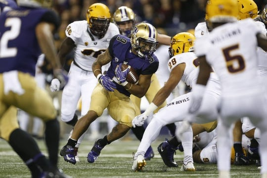 Sep 22, 2018; Seattle, WA, USA; Washington Huskies running back Myles Gaskin (9) runs against the Arizona State Sun defense during the second quarter at Husky Stadium. Mandatory Credit: Jennifer Buchanan-USA TODAY Sports