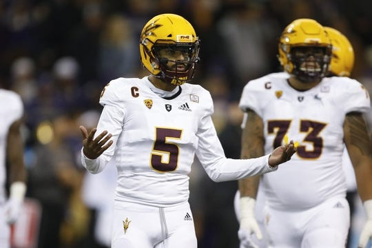 Sep 22, 2018; Seattle, WA, USA; Arizona State Sun Devils quarterback Manny Wilkins (5) gestures toward the sidelines during the second quarter against the Washington Huskies at Husky Stadium. Mandatory Credit: Jennifer Buchanan-USA TODAY Sports