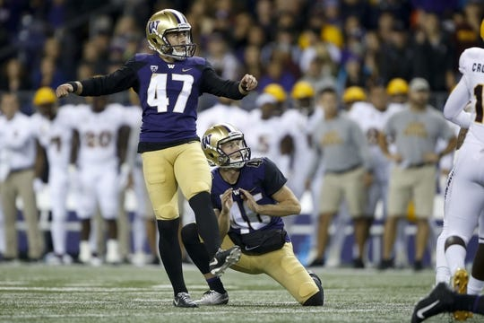 Sep 22, 2018; Seattle, WA, USA; Washington Huskies place kicker Peyton Henry (47) and punter Race Porter (46) watch as Henry's 26 yard field goal go through the uprights during the second quarter against the Arizona State Sun Devils at Husky Stadium. Mandatory Credit: Jennifer Buchanan-USA TODAY Sports