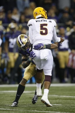 Sep 22, 2018; Seattle, WA, USA; Washington Huskies defensive back Jordan Miller (23) hits Arizona State Sun Devils quarterback Manny Wilkins (5) during the second quarter at Husky Stadium. Mandatory Credit: Jennifer Buchanan-USA TODAY Sports
