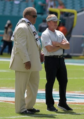 Sep 23, 2018; Miami Gardens, FL, USA; Oakland Raiders head coach Jon Gruden (left) and general manager Reggie McKenzie look on before a game against the Miami Dolphins at Hard Rock Stadium. Mandatory Credit: Kirby Lee-USA TODAY Sports