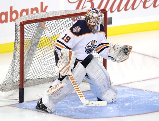 Sep 23, 2018; Winnipeg, Manitoba, CAN; Edmonton Oilers goalie Mikko Koskinen (19) in warms up before tonight's game against Winnipeg Jets at Bell MTS Place. Mandatory Credit: James Carey Lauder-USA TODAY Sports