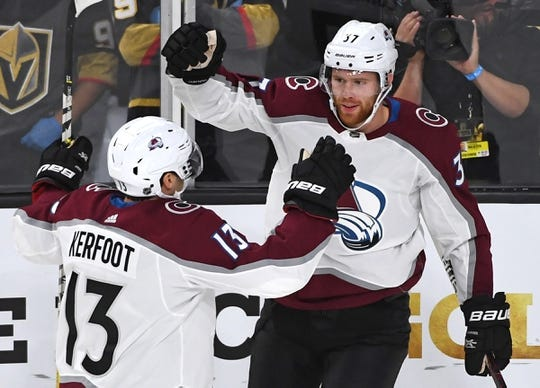 Sep 24, 2018; Las Vegas, NV, USA; Colorado Avalanche left wing J.T. Compher (37) celebrates with center Alexander Kerfoot (13) after scoring a first period goal against the Vegas Golden Knights at T-Mobile Arena. Mandatory Credit: Stephen R. Sylvanie-USA TODAY Sports