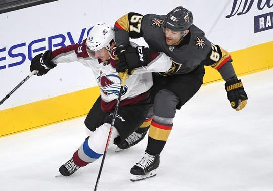 Sep 24, 2018; Las Vegas, NV, USA; Vegas Golden Knights left wing Max Pacioretty (67) slows down Colorado Avalanche defenseman Samuel Girard (49) during the first period at T-Mobile Arena. Mandatory Credit: Stephen R. Sylvanie-USA TODAY Sports