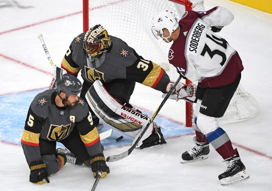 Sep 24, 2018; Las Vegas, NV, USA; Colorado Avalanche center Carl Soderberg (34) scores a first period power play goal against Vegas Golden Knights goaltender Malcolm Subban (30) at T-Mobile Arena. Mandatory Credit: Stephen R. Sylvanie-USA TODAY Sports