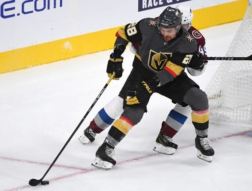 Sep 24, 2018; Las Vegas, NV, USA; Vegas Golden Knights left wing William Carrier (28) protects the puck from Colorado Avalanche defenseman Samuel Girard (49) during the first period at T-Mobile Arena. Mandatory Credit: Stephen R. Sylvanie-USA TODAY Sports