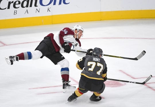 Sep 24, 2018; Las Vegas, NV, USA; Colorado Avalanche center Carl Soderberg (34) shoots against Vegas Golden Knights defenseman Brad Hunt (77) during the first period at T-Mobile Arena. Mandatory Credit: Stephen R. Sylvanie-USA TODAY Sports