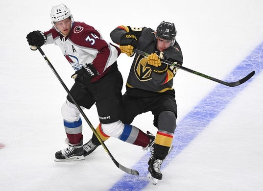 Sep 24, 2018; Las Vegas, NV, USA; Vegas Golden Knights right wing Reilly Smith (19) checks Colorado Avalanche center Carl Soderberg (34) during the first period at T-Mobile Arena. Mandatory Credit: Stephen R. Sylvanie-USA TODAY Sports