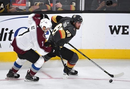 Sep 24, 2018; Las Vegas, NV, USA; Vegas Golden Knights right wing Alex Tuch (89) skates ahead of Colorado Avalanche defenseman Mark Alt (7) during the second period at T-Mobile Arena. Mandatory Credit: Stephen R. Sylvanie-USA TODAY Sports