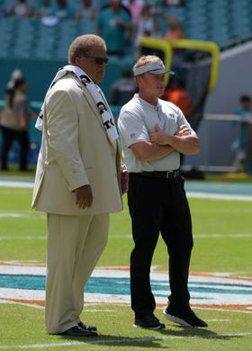 Sep 23, 2018; Miami Gardens, FL, USA; Oakland Raiders head coach Jon Gruden (left) and general manager Reggie McKenzie before the game against the Miami Dolphins at Hard Rock Stadium. Mandatory Credit: Kirby Lee-USA TODAY Sports