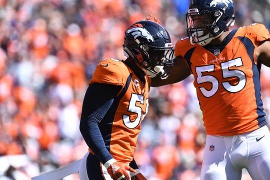 Sep 16, 2018; Denver, CO, USA; Denver Broncos linebacker Von Miller (58) celebrates his sack with linebacker Bradley Chubb (55) in the first quarter at Broncos Stadium at Mile High. Mandatory Credit: Ron Chenoy-USA TODAY Sports