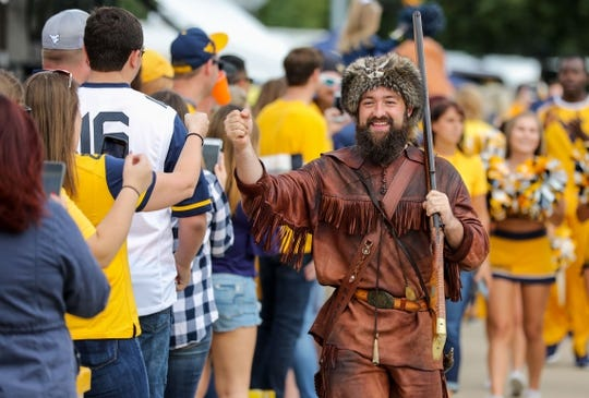 Sep 22, 2018; Morgantown, WV, USA; The West Virginia Mountaineers mascot leads the team into the stadium before their game against the Kansas State Wildcats at Mountaineer Field at Milan Puskar Stadium. Mandatory Credit: Ben Queen-USA TODAY Sports