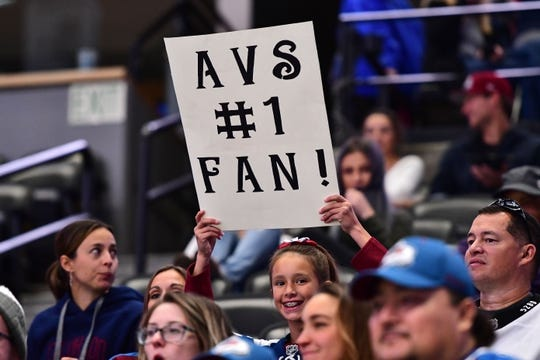 Sep 26, 2018; Denver, CO, USA; Colorado Avalanche fan holds a sign for her team in the first period against the Dallas Stars at Pepsi Center. Mandatory Credit: Ron Chenoy-USA TODAY Sports