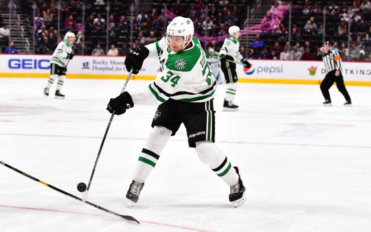 Sep 26, 2018; Denver, CO, USA; Dallas Stars left wing Denis Gurianov (34) attempts a shot on goal in the first period against the Colorado Avalanche at Pepsi Center. Mandatory Credit: Ron Chenoy-USA TODAY Sports