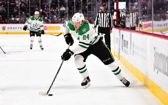 Sep 26, 2018; Denver, CO, USA; Dallas Stars center Rope Hintz (24) controls the puck during the first period against the Colorado Avalanche at Pepsi Center. Mandatory Credit: Ron Chenoy-USA TODAY Sports