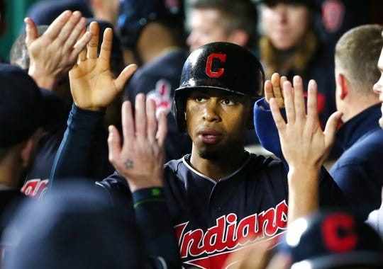 Sep 27, 2018; Kansas City, MO, USA; Cleveland Indians shortstop Francisco Lindor (12) is congratulated by teammates after scoring against the Kansas City Royals in the first inning at Kauffman Stadium. Mandatory Credit: Jay Biggerstaff-USA TODAY Sports