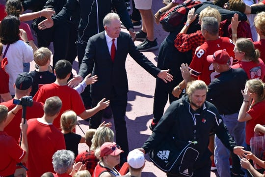 Sep 29, 2018; Louisville, KY, USA; Louisville Cardinals head coach Bobby Petrino greets fans during the Card March before facing off against the  Florida State Seminoles at Cardinal Stadium. Mandatory Credit: Jamie Rhodes-USA TODAY Sports
