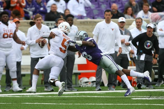 Sep 29, 2018; Manhattan, KS, USA; Texas Longhorns running back Tre Watson (5) is tackled by Kansas State Wildcats defensive back Duke Shelley (8) during the first quarter at Bill Snyder Family Stadium. Mandatory Credit: Scott Sewell-USA TODAY Sports