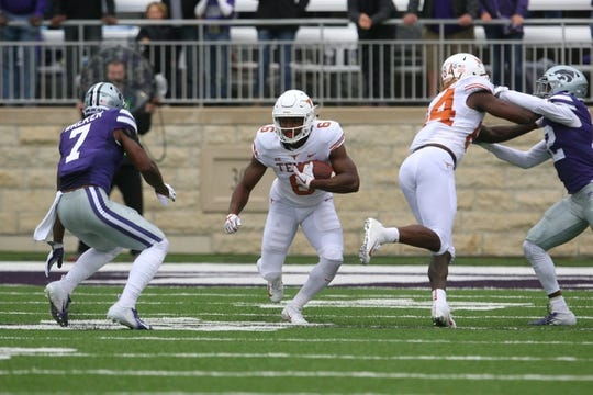 Sep 29, 2018; Manhattan, KS, USA; Texas Longhorns wide receiver Devin Duvernay (6) looks for room to run against Kansas State Wildcats defensive back Eli Walker (7) during the first quarter at Bill Snyder Family Stadium. Mandatory Credit: Scott Sewell-USA TODAY Sports