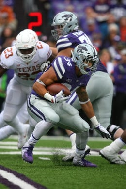 Sep 29, 2018; Manhattan, KS, USA; Kansas State Wildcats running back Alex Barnes (34) looks for room to run during the first quarter against the Texas Longhorns at Bill Snyder Family Stadium. Mandatory Credit: Scott Sewell-USA TODAY Sports
